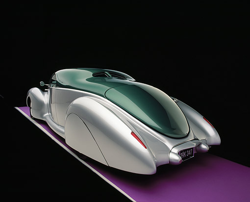AUT 19 RK0621 05 © Kimball Stock 1939 Lincoln, Zephyr, Almond Green And Silver 3/4 Rear View On Purple Floor Studio