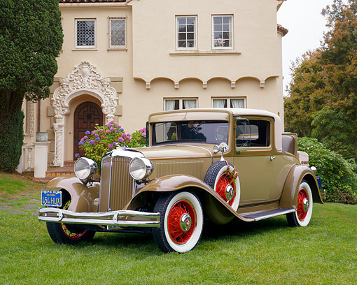AUT 19 RK0657 01 © Kimball Stock 1931 Chrysler CD8 Coupe Tan And Brown 3/4 Front View On Grass By House