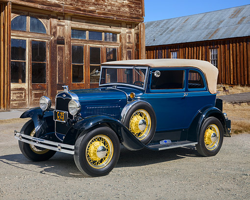 AUT 19 RK0689 01 © Kimball Stock 1931 Ford Model A 400 Convertible Sedan Washington Blue 3/4 Front View On Gravel By Buildling