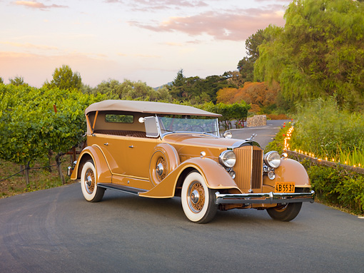 AUT 19 RK0739 01 © Kimball Stock 1934 Packard Touring Super Eight Nutmeg 3/4 Front View On Pavement By Vineyard