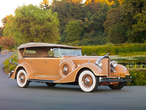 AUT 19 RK0743 01 © Kimball Stock 1934 Packard Touring Super Eight Nutmeg 3/4 Front View On Pavement By Pond