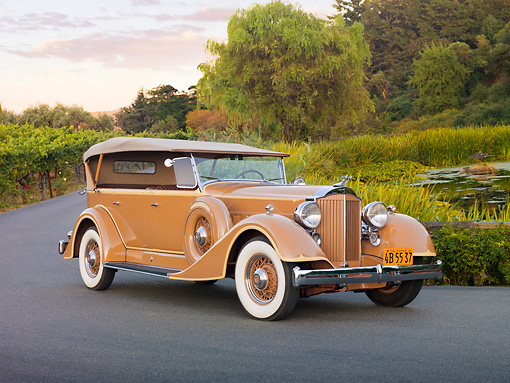 AUT 19 RK0744 01 © Kimball Stock 1934 Packard Touring Super Eight Nutmeg 3/4 Front View On Pavement By Pond