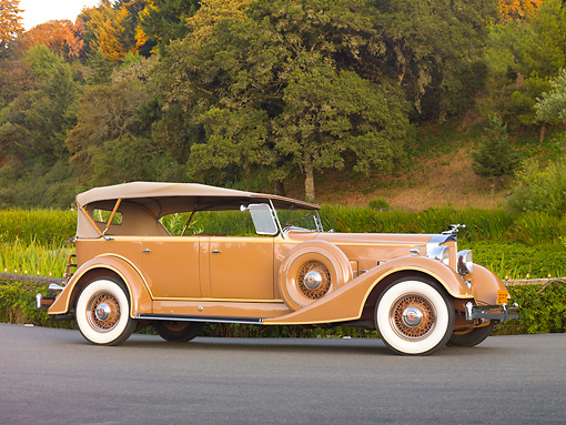 AUT 19 RK0746 01 © Kimball Stock 1934 Packard Touring Super Eight Nutmeg Profile View On Pavement By Trees