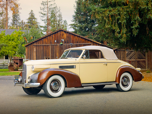 AUT 19 RK0749 01 © Kimball Stock 1939 La Salle Series 50 Convertible Cream And Brown 3/4 Front View On Pavement By Barn