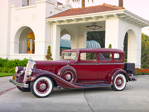 AUT 19 RK0750 01 © Kimball Stock 1933 Pierce-Arrow 1236 Twelve Sedan Maroon 3/4 Front View On Concrete By Building