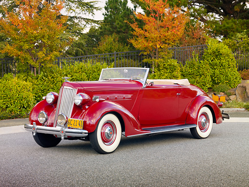 AUT 19 RK0755 01 © Kimball Stock 1936 Packard 120 Convertible Coupe Red 3/4 Front View On Pavement By Trees
