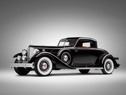 AUT 19 RK0786 01 © Kimball Stock 1933 Packard Twelve Custom Dietrich Coupe Black 3/4 Side View On White Seamless