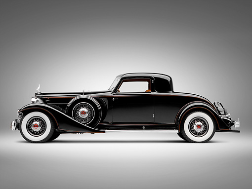 AUT 19 RK0787 01 © Kimball Stock 1933 Packard Twelve Custom Dietrich Coupe Black Profile View On White Seamless