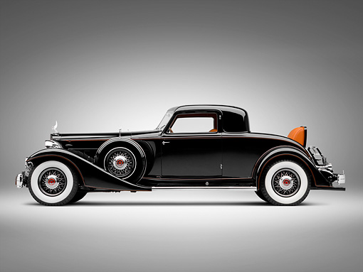 AUT 19 RK0788 01 © Kimball Stock 1933 Packard Twelve Custom Dietrich Coupe Black Profile View On White Seamless