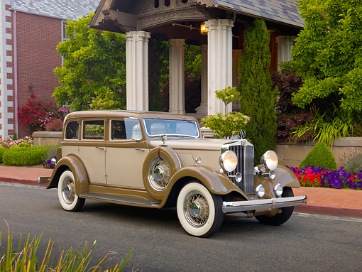 AUT 19 RK0798 01 © Kimball Stock 1932 Hupmobile F222 Brown And Tan 3/4 Front View On Pavement By Brick House