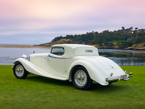 AUT 19 RK0820 01 © Kimball Stock 1933 Delage D8S De Villars Roadster White 3/4 Rear View On Grass By Water