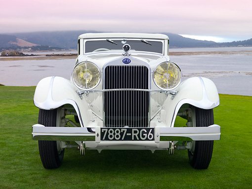 AUT 19 RK0823 01 © Kimball Stock 1933 Delage D8S De Villars Roadster White Head On View On Grass By Water
