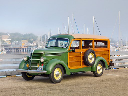 AUT 19 RK0834 01 © Kimball Stock 1937 International Station Wagon D-2 1/2 Ton Woodie Green 3/4 Front View On Pavement By Harbor