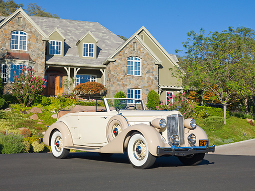 AUT 19 RK0835 01 © Kimball Stock 1935 Packard Convertible 1201 Cream 3/4 Front View On Pavement By House