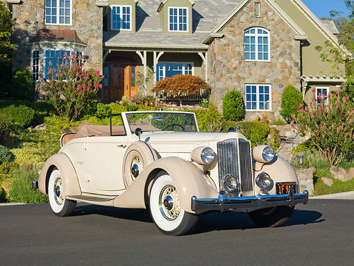 AUT 19 RK0836 01 © Kimball Stock 1935 Packard Convertible 1201 Cream 3/4 Front View On Pavement By House