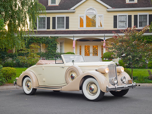 AUT 19 RK0840 01 © Kimball Stock 1935 Packard Convertible 1201 Cream 3/4 Side View On Pavement By House