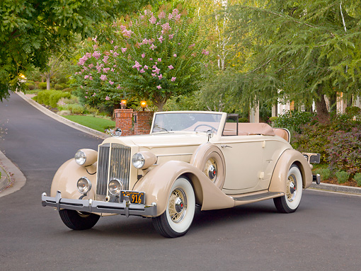 AUT 19 RK0843 01 © Kimball Stock 1935 Packard Convertible 1201 Cream 3/4 Front View On Pavement By Trees And House
