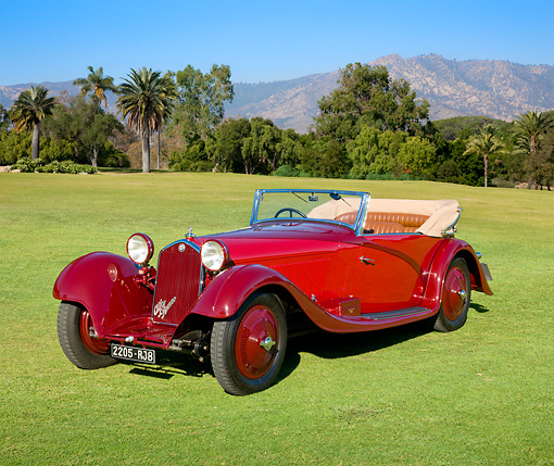 AUT 19 RK0845 01 © Kimball Stock 1934 Alfa Romeo 8C 2300 Red 3/4 Front View On Grass