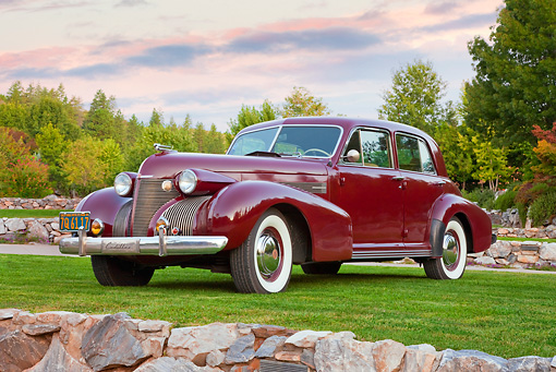 AUT 19 RK0871 01 © Kimball Stock 1939 Cadillac Special Sedan Burgundy 3/4 Front View On Grass By Autumn Trees