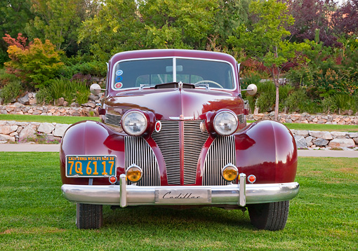 AUT 19 RK0872 01 © Kimball Stock 1939 Cadillac Special Sedan Burgundy Head On View On Grass By Trees