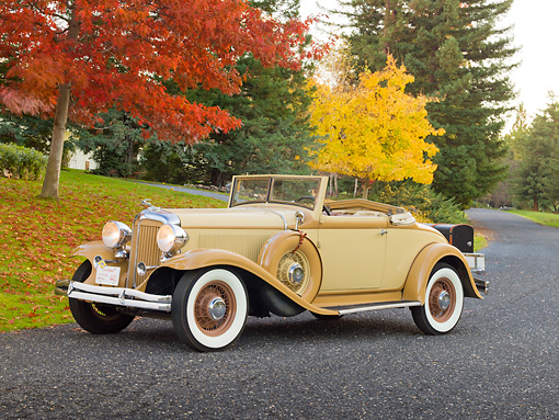 AUT 19 RK0875 01 © Kimball Stock 1932 Chrysler Convertible Coupe Beige 3/4 Front View On Pavement By Autumn Trees