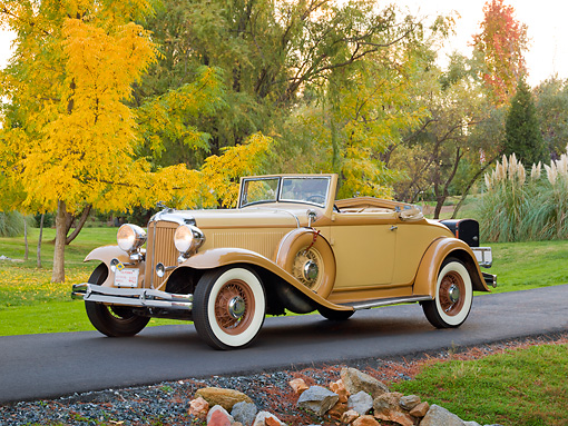 AUT 19 RK0876 01 © Kimball Stock 1932 Chrysler Convertible Coupe Beige 3/4 Front View On Pavement By Grass And Autumn Trees