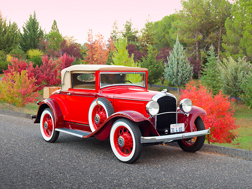 AUT 19 RK0882 01 © Kimball Stock 1931 Plymouth Convertible Coupe Red 3/4 Front View On Pavement By Autumn Trees