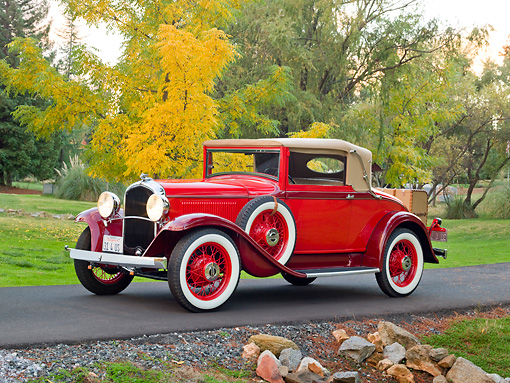 AUT 19 RK0884 01 © Kimball Stock 1931 Plymouth Convertible Coupe Red 3/4 Front View On Pavement By Autumn Trees