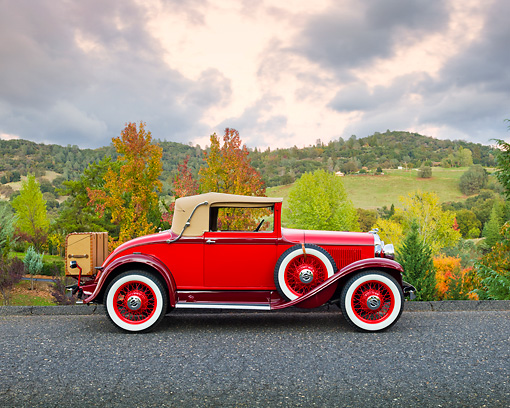 AUT 19 RK0885 01 © Kimball Stock 1931 Plymouth Convertible Coupe Red Profile View On Pavement By Autumn Trees
