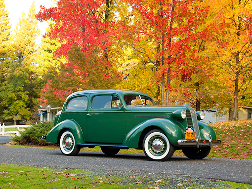 AUT 19 RK0892 01 © Kimball Stock 1936 Pontiac Touring Sedan Green 3/4 Side View On Pavement By Autumn Trees