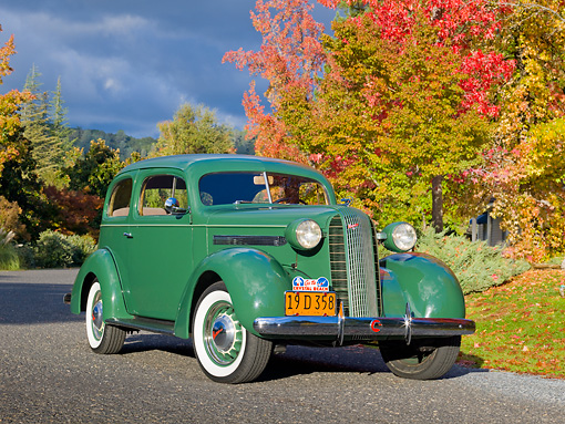 AUT 19 RK0893 01 © Kimball Stock 1936 Pontiac Touring Sedan Green 3/4 Front View On Pavement By Autumn Trees