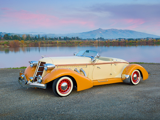 AUT 19 RK0904 01 © Kimball Stock 1936 Auburn Speedster Tan And Brown 3/4 Front View On Gravel By Lake At Dusk