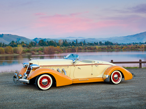 AUT 19 RK0905 01 © Kimball Stock 1936 Auburn Speedster Tan And Brown 3/4 Side View On Gravel By Lake At Dusk