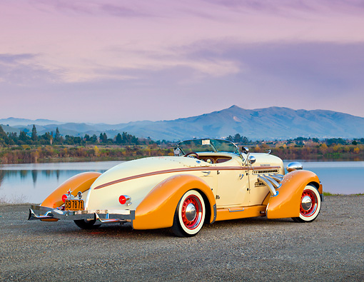 AUT 19 RK0907 01 © Kimball Stock 1936 Auburn Speedster Tan And Brown 3/4 Rear View On Gravel By Lake At Dusk
