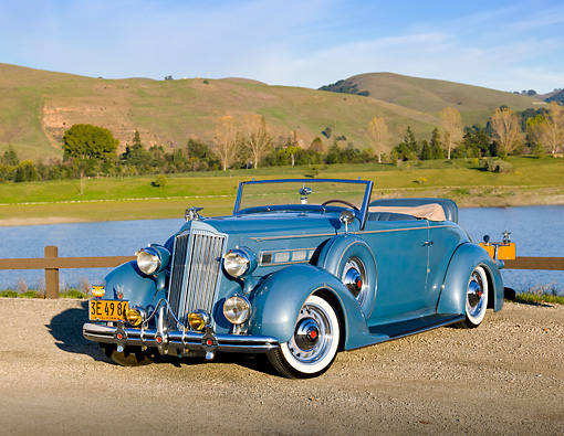 AUT 19 RK0910 01 © Kimball Stock 1936 Packard 120 Convertible Blue 3/4 Front View On Gravel By Hills And Lake