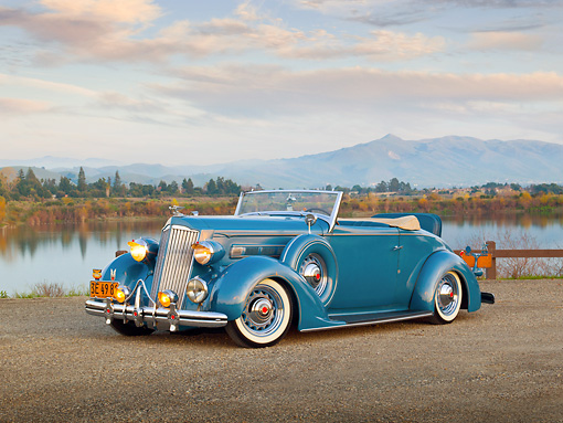 AUT 19 RK0911 01 © Kimball Stock 1936 Packard 120 Convertible Blue 3/4 Front View On Gravel By Hills And Lake