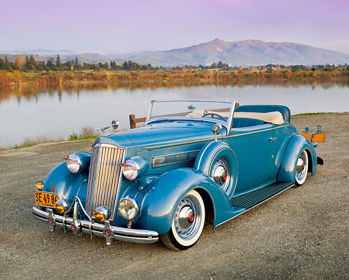 AUT 19 RK0913 01 © Kimball Stock 1936 Packard 120 Convertible Blue 3/4 Front View On Gravel By Lake