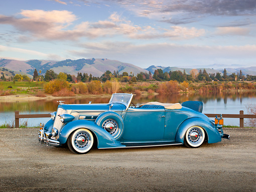 AUT 19 RK0914 01 © Kimball Stock 1936 Packard 120 Convertible Blue 3/4 Side View On Gravel By Lake At Dusk