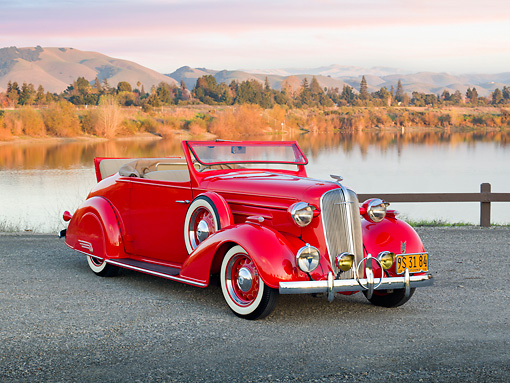 AUT 19 RK0915 01 © Kimball Stock 1936 Chevrolet Roadster Red 3/4 Front View On Gravel By Lake
