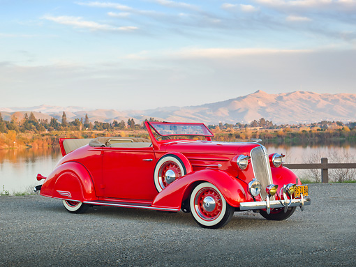 AUT 19 RK0917 01 © Kimball Stock 1936 Chevrolet Roadster Red 3/4 Front View On Gravel By Lake