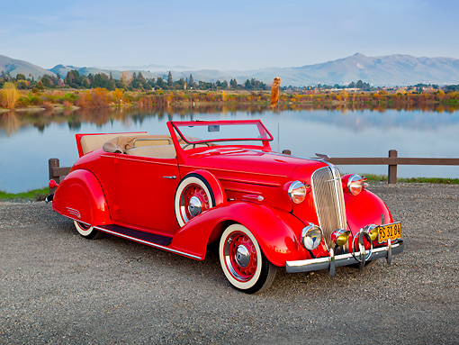 AUT 19 RK0918 01 © Kimball Stock 1936 Chevrolet Roadster Red 3/4 Front View On Gravel By Lake