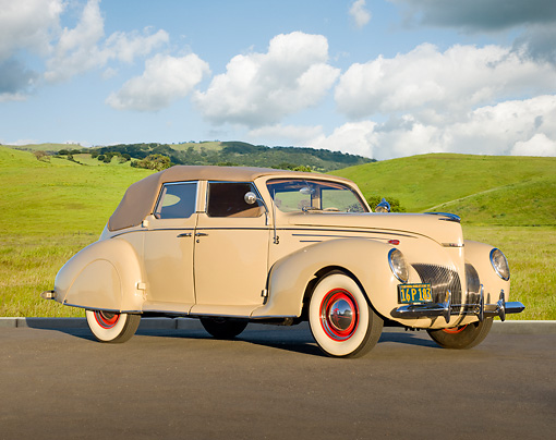 AUT 19 RK0923 01 © Kimball Stock 1939 Lincoln Zephyr Convertible Cream 3/4 Front View On Pavement By Grassy Hills