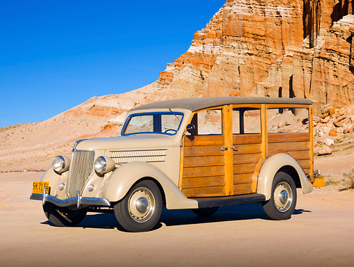 AUT 19 RK0930 01 © Kimball Stock 1936 Ford Woodie Station Wagon Brown 3/4 Side View On Sand By Red Rock