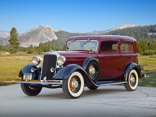 AUT 19 RK0940 01 © Kimball Stock 1933 Dodge DP Maroon And Black 3/4 Front View On Concrete By Mountains