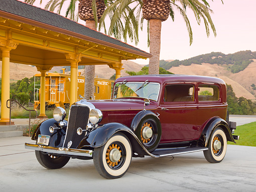 AUT 19 RK0941 01 © Kimball Stock 1933 Dodge DP Maroon And Black 3/4 Front View On Concrete By Train Station