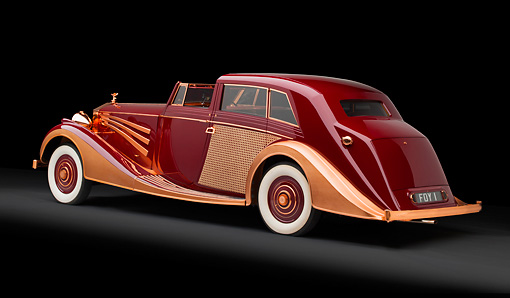 AUT 19 RK0949 01 © Kimball Stock 1937 Rolls-Royce Phantom III Freestone & Webb Sedanca Red And Copper 3/4 Rear View In Studio