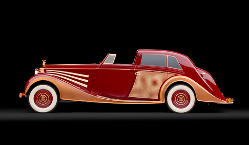 AUT 19 RK0950 01 © Kimball Stock 1937 Rolls-Royce Phantom III Freestone & Webb Sedanca Red And Copper Profile View In Studio