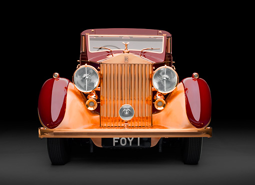 AUT 19 RK0951 01 © Kimball Stock 1937 Rolls-Royce Phantom III Freestone & Webb Sedanca Red And Copper Front View In Studio
