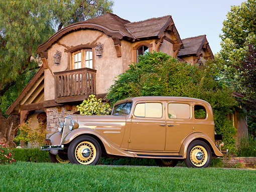 AUT 19 RK0962 01 © Kimball Stock 1935 Chevrolet Sedan Hollywood Tan Profile View On Pavement By House