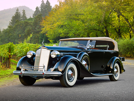 AUT 19 RK0970 01 © Kimball Stock 1937 Packard 1507 Sport Phaeton Black 3/4 Front View On Pavement By Trees